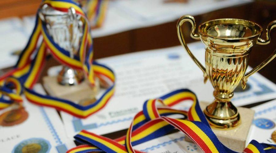 Burse pentru olimpicii care rămân în România