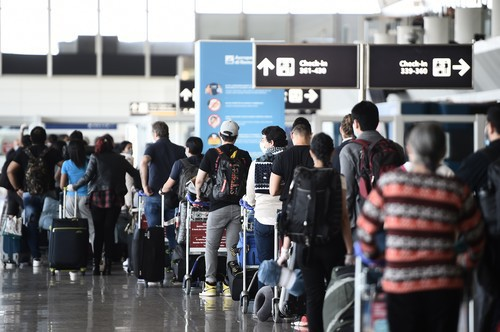 Travelers wait to check in at Rome's Fiumicino airport on June 3, 2020, as airports and borders reopen for tourists and residents free to travel across the country, within the COVID-19 infection, caused by the novel coronavirus.,Image: 526153156, License: Rights-managed, Restrictions: , Model Release: no
