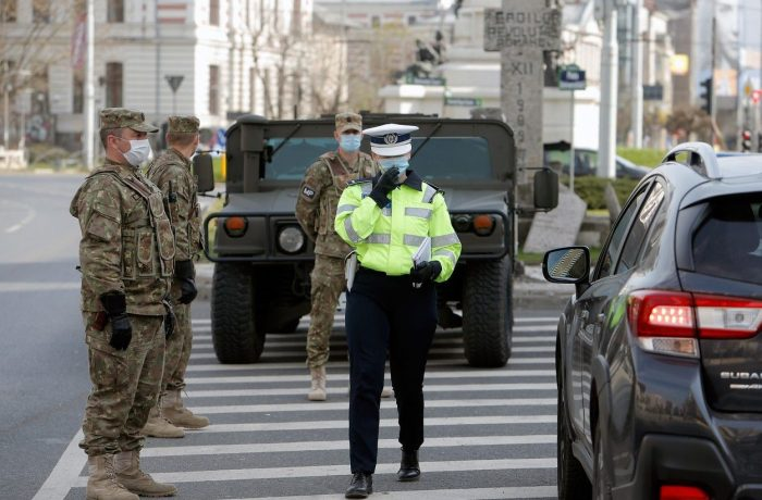 (200329) -- BUCHAREST, March 29, 2020 () -- A policeman and soldiers are seen in Bucharest, Romania, March 28, 2020. Romania announced a nationwide lockdown from Wednesday morning, after a curfew which had been introduced previously since Sunday evening. The country entered a state of emergency on March 16 after the number of COVID-19 cases exceeded 100., Image: 510597374, License: Rights-managed, Restrictions: WORLD RIGHTS excluding China - Fee Payable Upon Reproduction - For queries contact Avalon.red - sales@avalon.red London: +44 (0) 20 7421 6000 Los Angeles: +1 (310) 822 0419 Berlin: +49 (0) 30 76 212 251, Model Release: no, Credit line: Xinhua/Avalon.red / Avalon Editorial / Profimedia